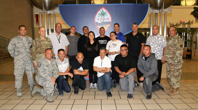 Airmen from the Guam Air National Guard's 254th Security Forces Squadron, pose for a photo with Guam National Guard leadership prior to departing for a deployment in support of Operation Inherent Resolve in Southwest Asia.