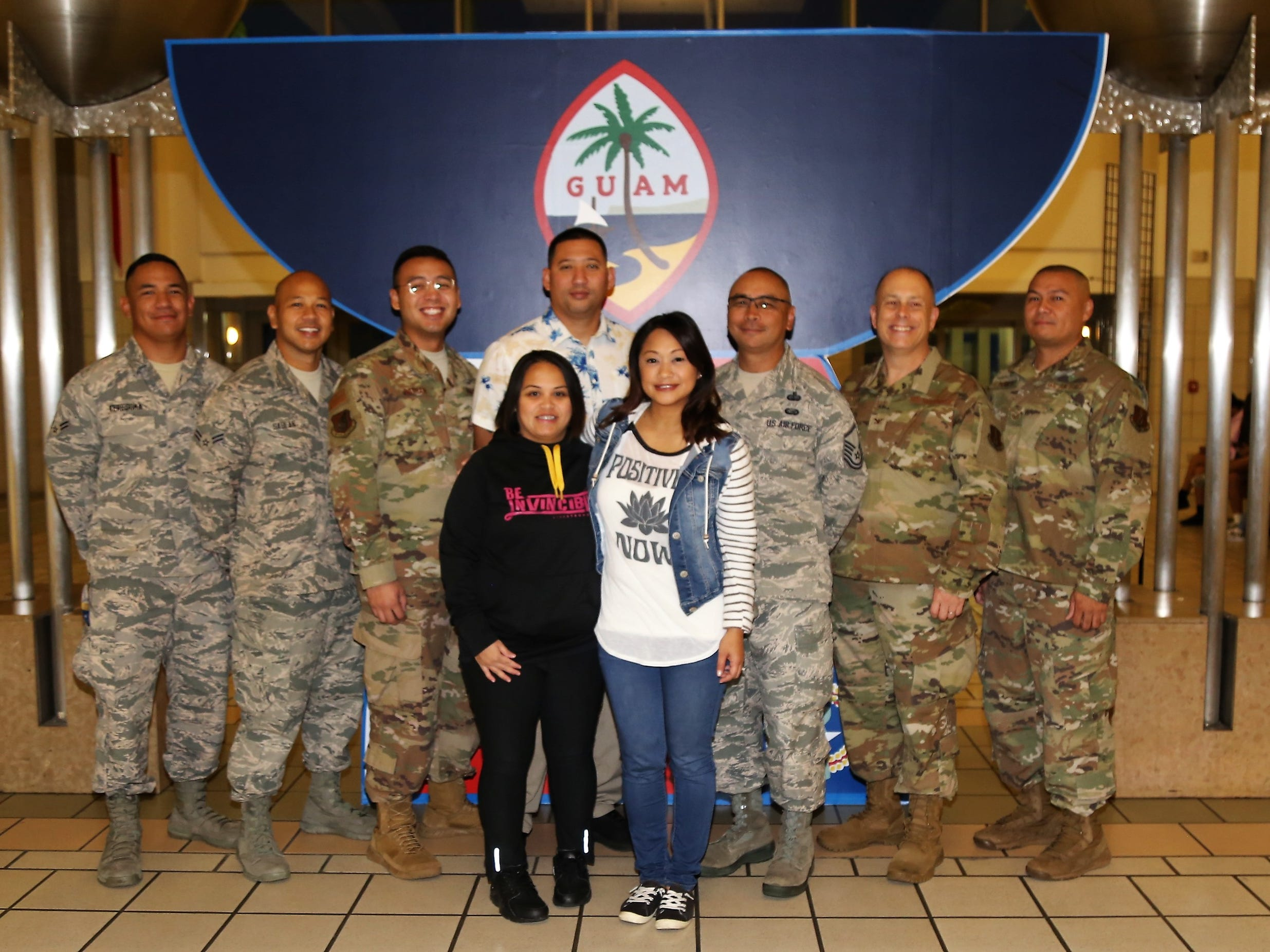 Technical Sgt. Michelle Castro in white prior to departing for a deployment in support of Operation Inherent Resolve in Southwest Asia.