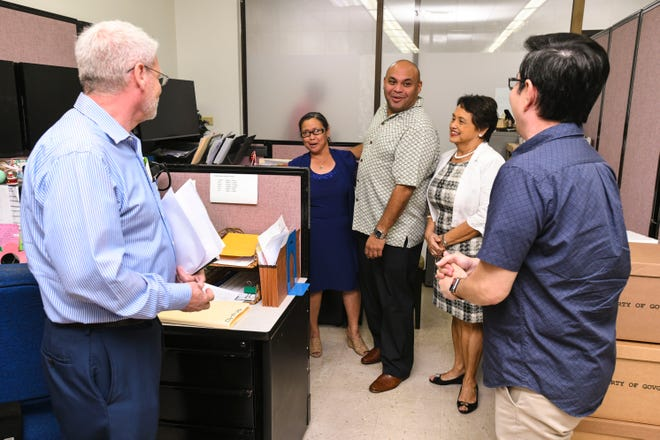 Lt. Gov. Josh Tenorio recognizes Payroll Technician Paz Flores during a visit to the Payroll Branch of the Department of Administration in Tamuning with Gov. Lou Leon Guerrero and others on Wednesday, Jan. 10, 2019.