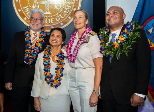 From left: First Gentleman of Guam Jeff Cook; Governor of Guam Lou Leon Guerrero; Rear Adm. Shoshana Chatfield, commander, Joint Region Marianas; and Lieutenant Governor of Guam Joshua Tenorio smile for a photo during Guam's 13th gubernatorial inauguration at the University of Guam Calvo Field House in Mangilao Jan. 7. During the inauguration, Leon Guerrero and Tenorio took their oaths of office and delivered inaugural speeches among other ceremonial festivities.
