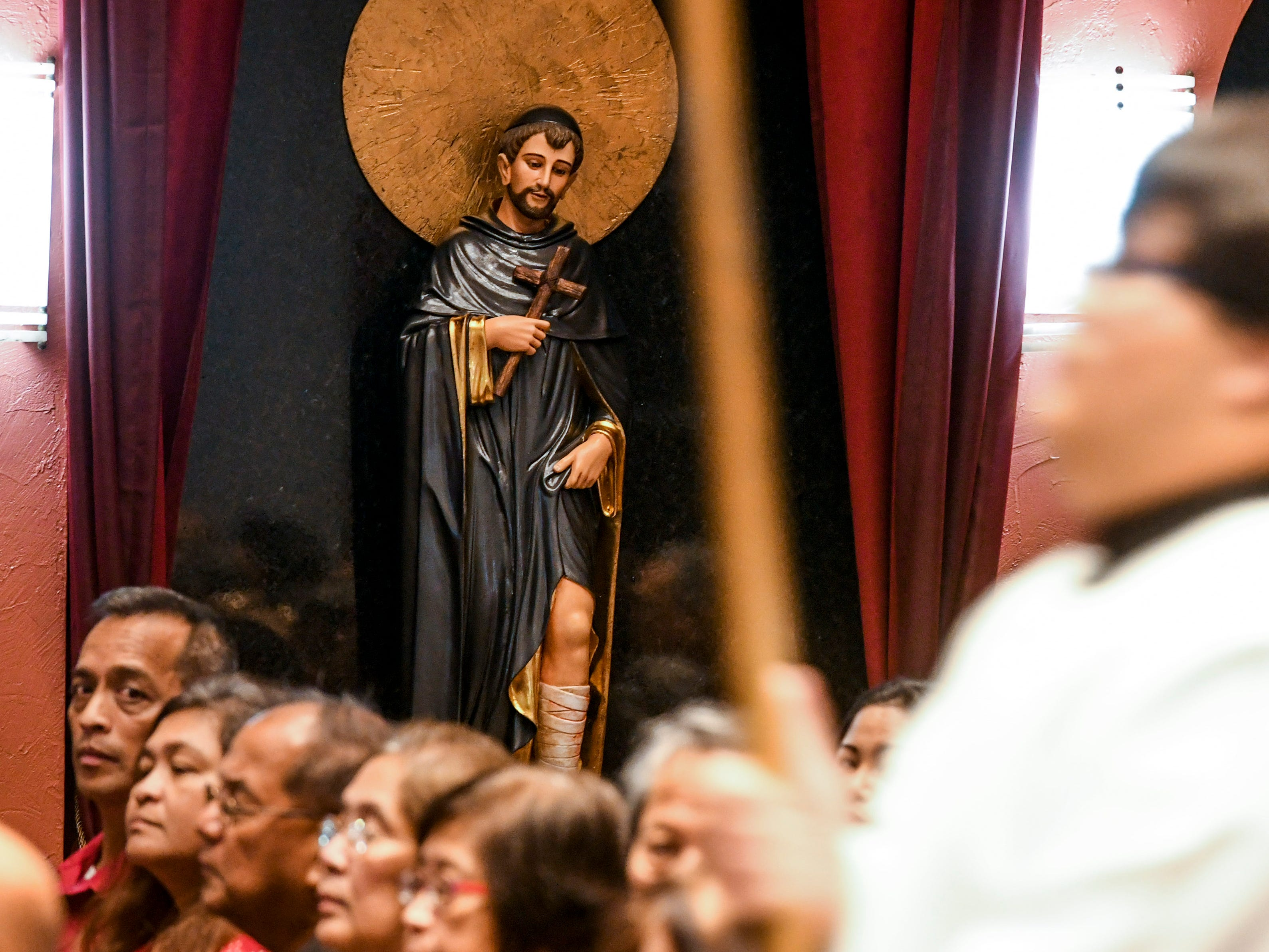 The newly enthroned statue of St. Peregrine stares out onto parishioners during the inaugural devotion Mass to the saint at the Dulce Nombre de Maria Cathedral-Basilica in Hagåtña on Wednesday, Jan. 9, 2019. The Archdiocese of Agaña announced that Mass will be offered at 6:00 p.m. on Wednesdays for cancer patients, their families and all who would like to participate in celebration of the Eucharist and prayers. Confession will also be offered before each Mass, as well as an anointing of the sick, said Monsignor James Benavente, pastor of the Cathedral-Basilica.