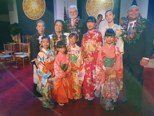 Mizuno-kai, a Japanese traditional dance group led by Yaeko Smith performed to celebrate a new governor at the inauguration ceremony on January 7.    From left:  Yaeko Smith, Seiko Yamashiro, Sae Koda, Kelli Tokito, Aiko Gonda, Michelle Sule, Nozomi Shimizu along with Gov. Lou Leon Guerrero, Jeffrey Cook, and Lt. Gov. Josh Tenorio.