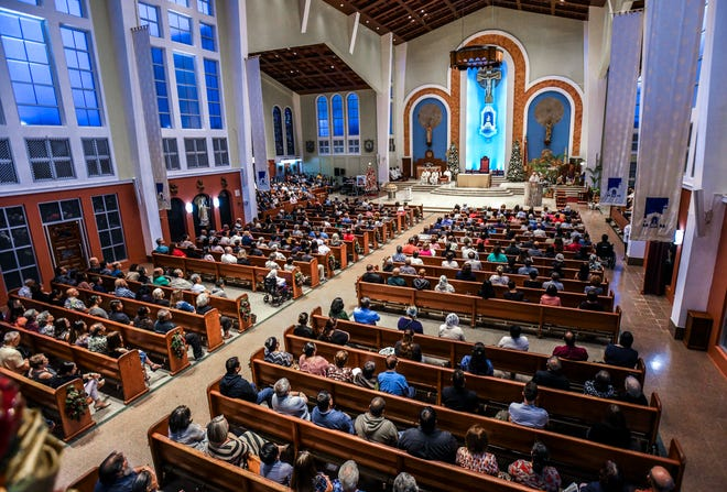 Parishioners fill the Dulce Nombre de Maria Cathedral-Basilica during the inaugural devotion Mass to St. Peregrine in Hagåtña on Wednesday, Jan. 9, 2019. An unveiling, blessing and enthronement of a statue of St. Peregrine was held during the Mass. The Archdiocese of Agaña announced that Mass will be offered at 6:00 p.m. on Wednesdays for cancer patients, their families and all who would like to participate in celebration of the Eucharist and prayers. Confession will also be offered before each Mass, as well as an anointing of the sick, said Monsignor James Benavente, pastor of the Cathedral-Basilica.