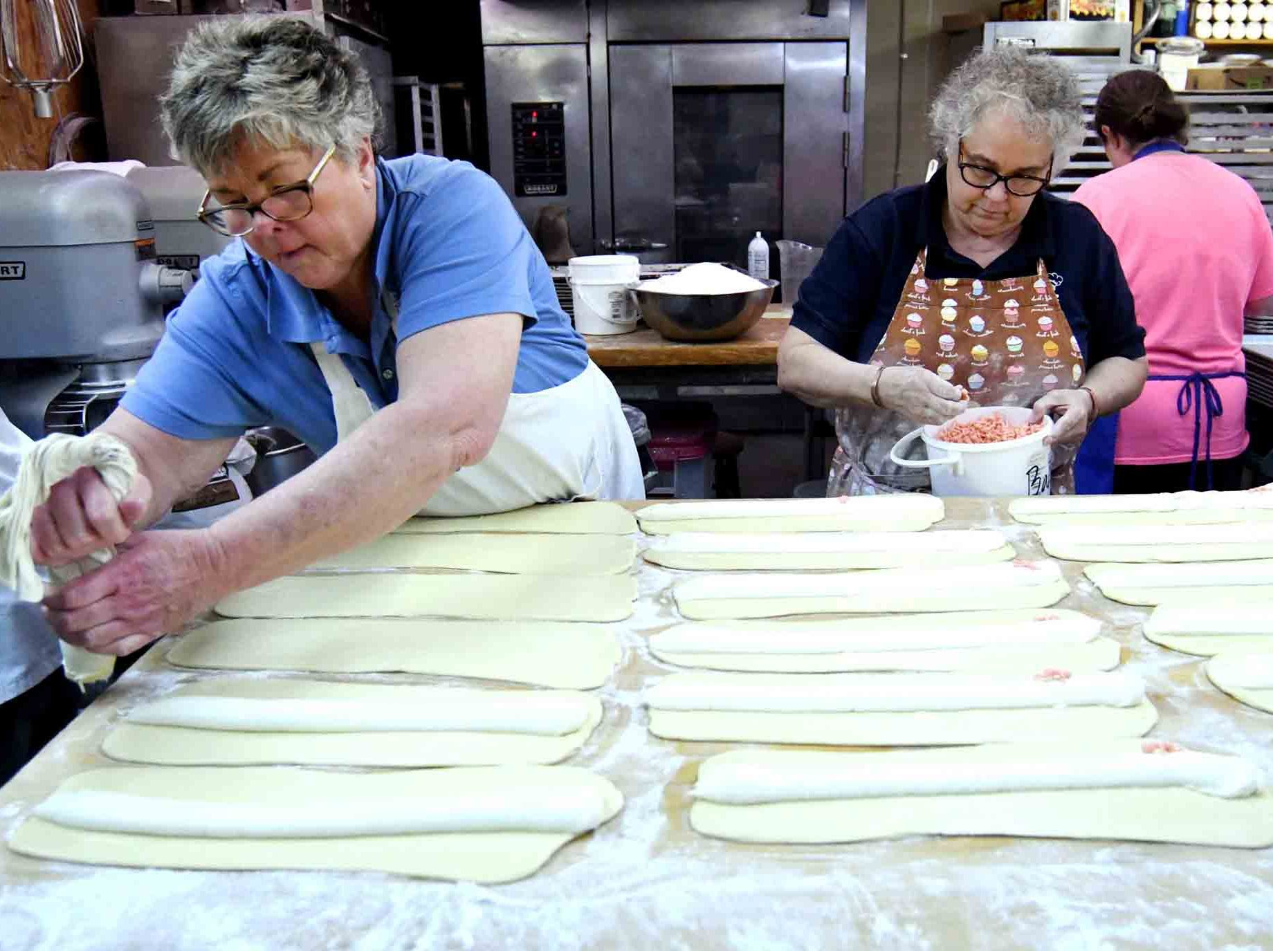Jade Rock, right, and Jody Lopez, left, start the process of making king cakes at Jody's Bakery in Hattiesburg. The bakery provides around 15 different flavors of king cakes. They can be found at Keith's Superstore, Strick's BBQ and Pier 98.