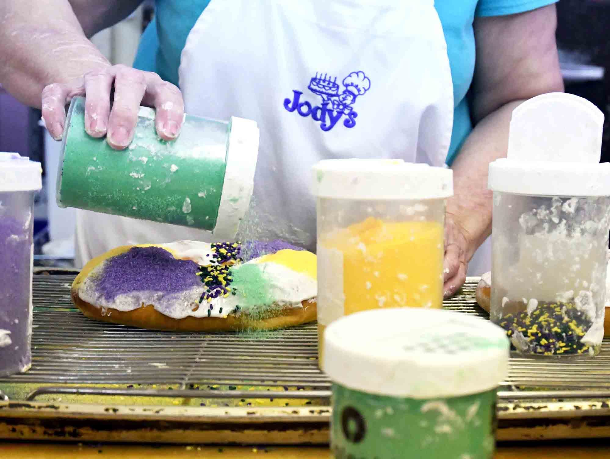 Shirley Nichols adds sugar and sprinkles to the king cakes at Jody's Bakery in Hattiesburg. The bakery provides around 15 different flavors of king cakes. They can be found at Keith's Superstore, Strick's BBQ and Pier 98.