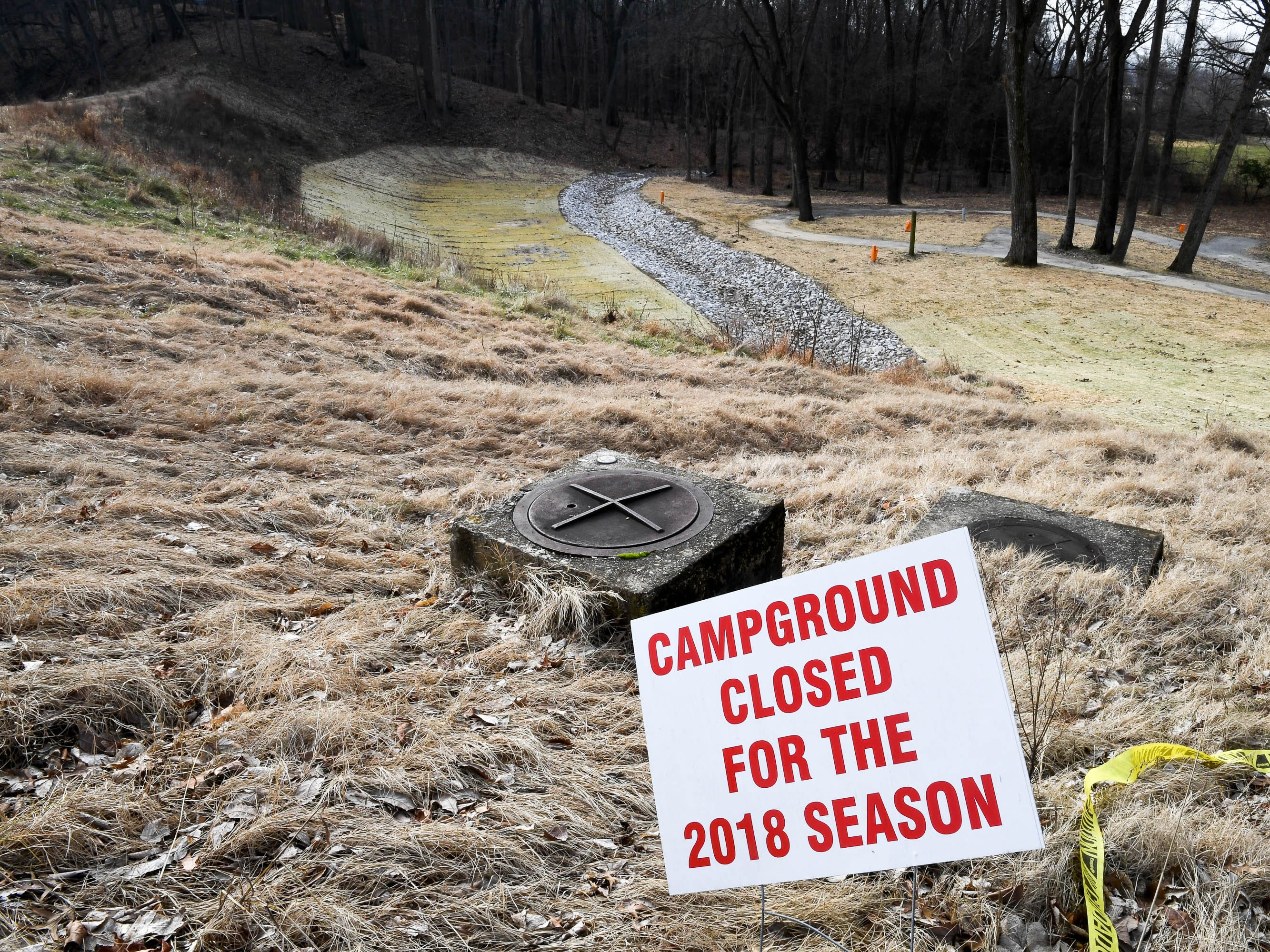 The Scenic Lake dam and the campground behind it at Henderson's John James Audubon State Park Thursday. Closed for the 2018 season for repair and stabilization work, will possibly be closed for all or part of the 2019 season also, January 3, 2019.