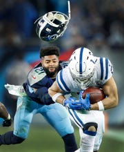 Matt Kryger's winning action photo: Tennessee Titans cornerback Malcolm Butler loses his helmet as he tries to tackle Indianapolis Colts running back Jordan Wilkins on Dec. 30, 2018.