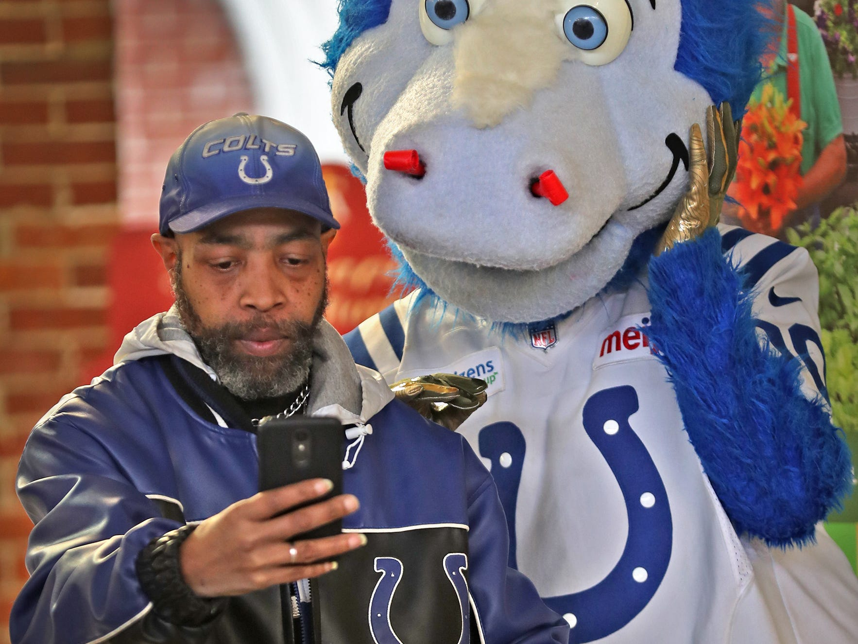 David Woods gets a selfie with Colts mascot Blue at the City Market.  Fans had the opportunity to sign a 1-0 banner for the Colts at City Market, Thursday, Jan. 10, 2019.  The banner will be displayed for the team to see at the airport as they head off to their Kansas City playoff game.