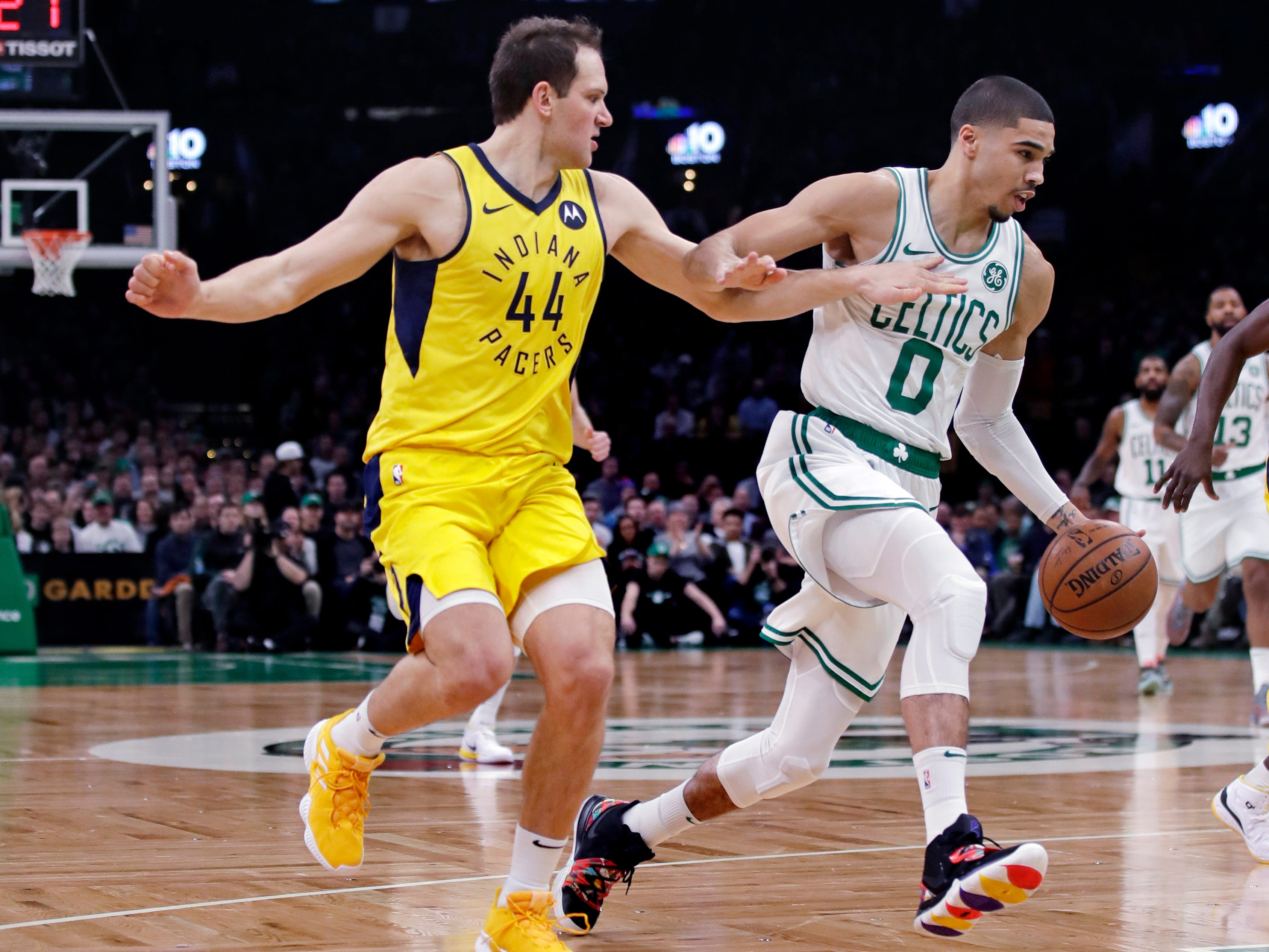 Boston Celtics forward Jayson Tatum (0) drives to the basket past Indiana Pacers forward Bojan Bogdanovic (44) during the first quarter of an NBA basketball game in Boston, Wednesday, Jan. 9, 2019.