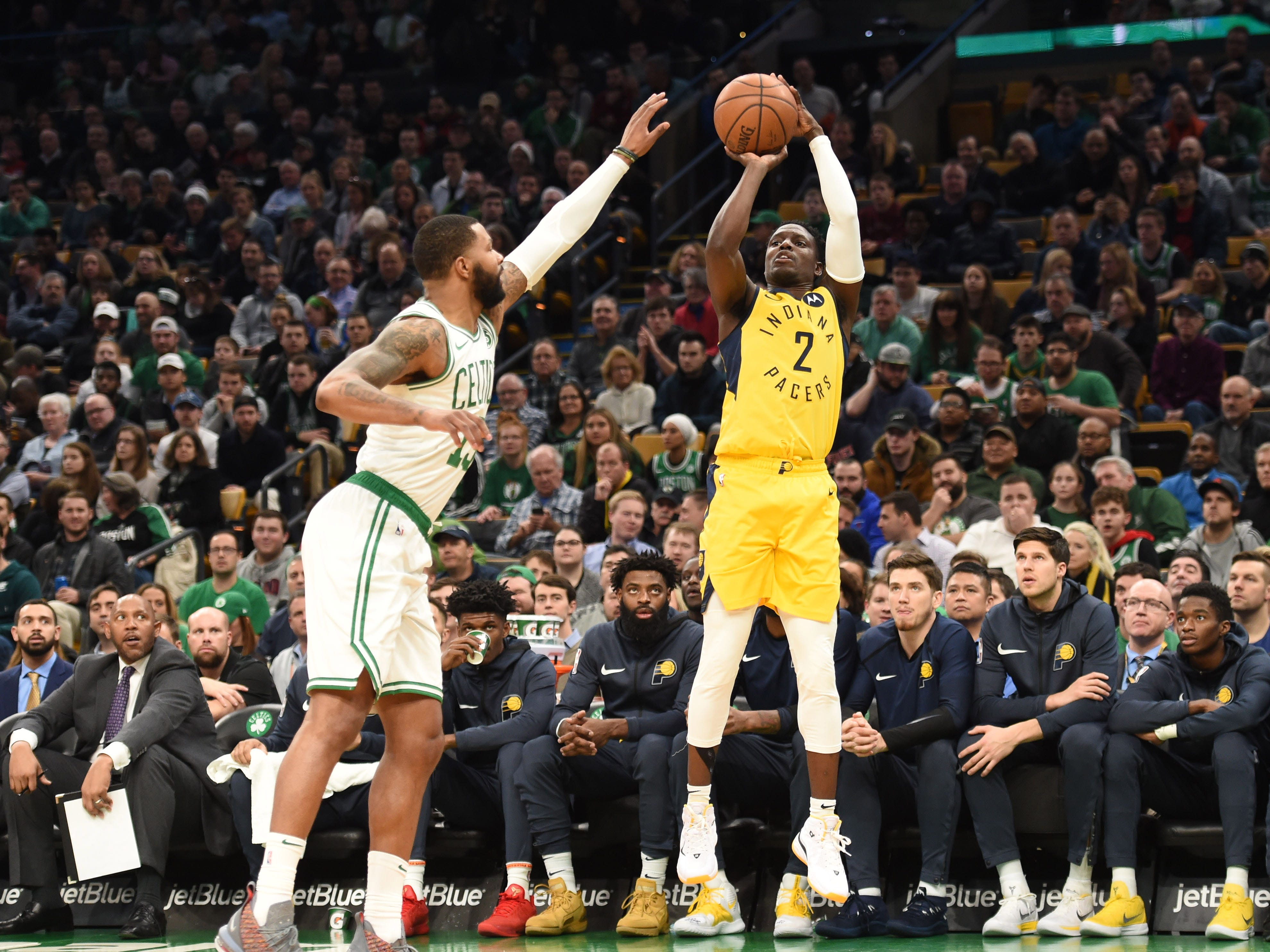 Jan 9, 2019; Boston, MA, USA; Indiana Pacers guard Darren Collison (2) shoots the ball against Boston Celtics forward Marcus Morris (13) during the first half at TD Garden.