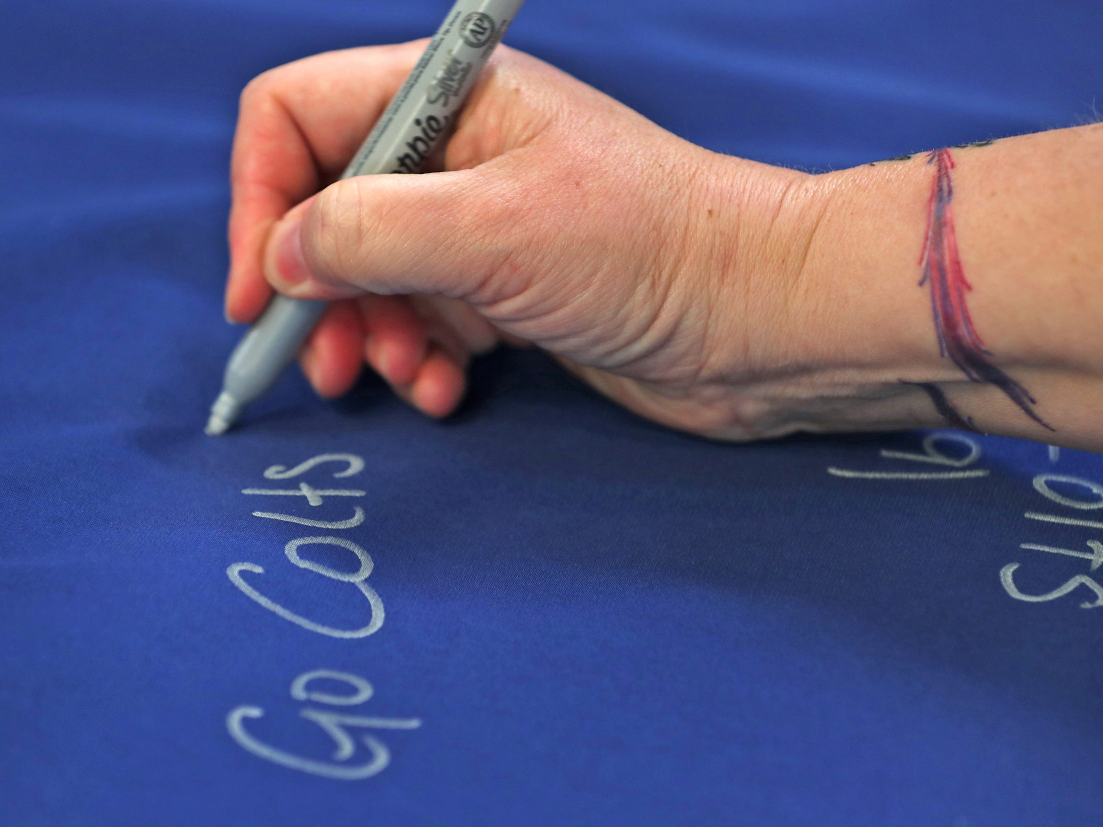 Fans sign a 1-0 banner for the Colts at City Market, Thursday, Jan. 10, 2019.  The banner will be displayed for the team to see at the airport as they head off to their Kansas City playoff game.