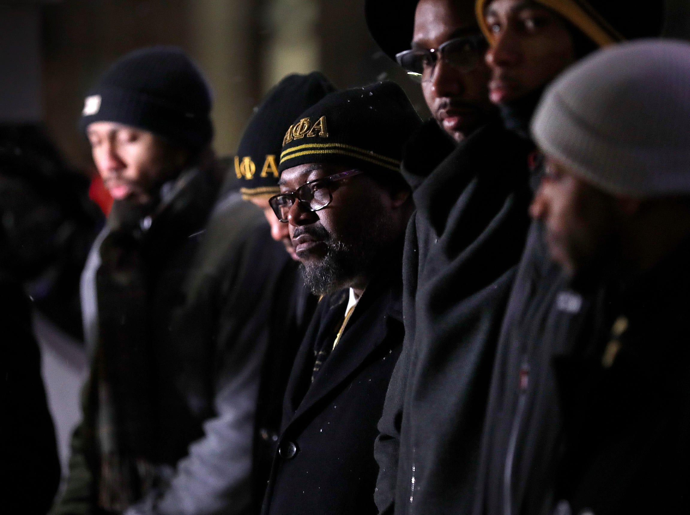 Members of the Alpha Phi Alpha stand by the wreath as the Indiana Civil Rights Commission hosted a commemorative Wreath Placing Ceremony at the Indiana War Memorial on Wednesday, Jan. 9, 2019.