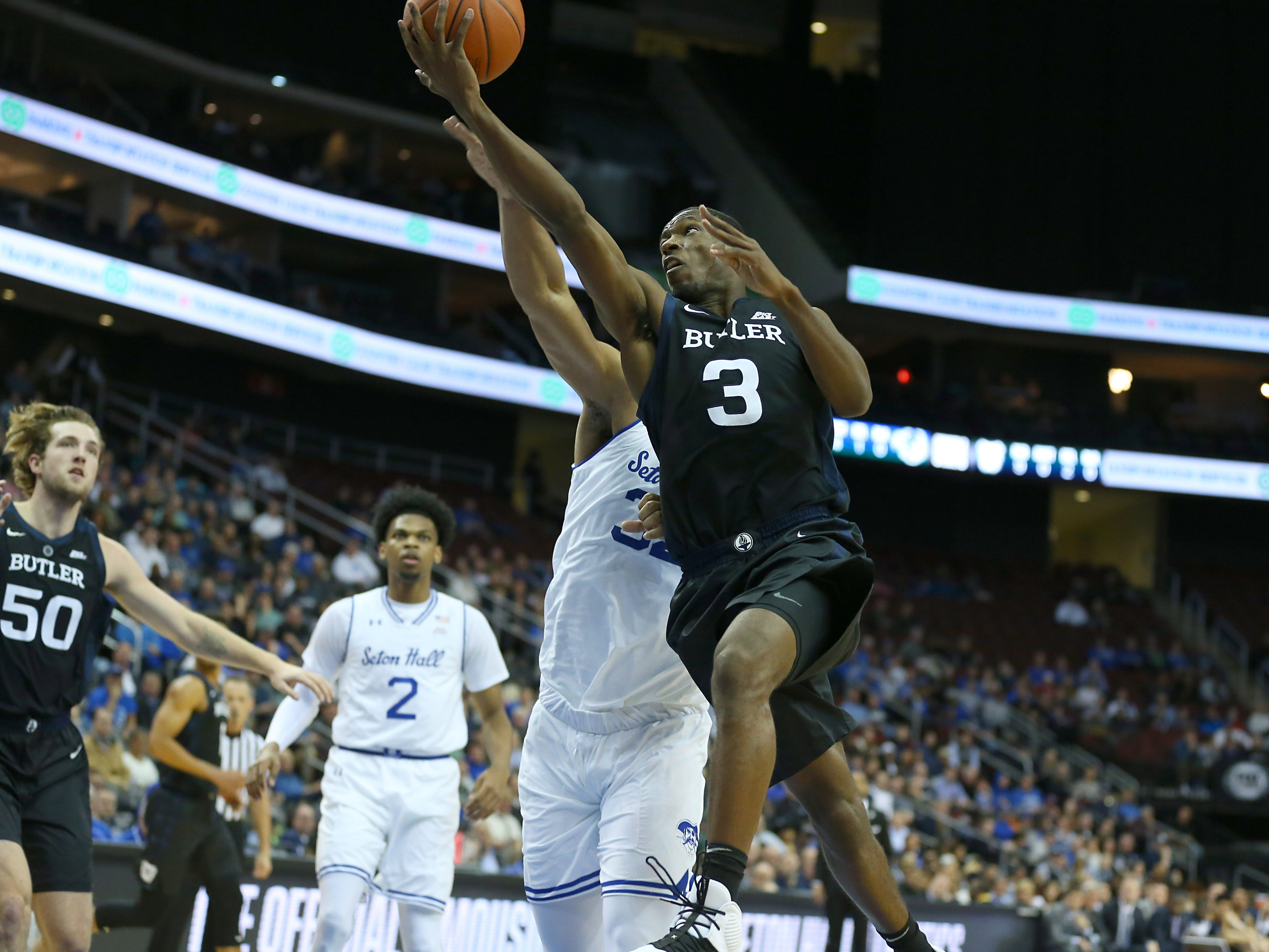 Jan 9, 2019; Newark, NJ, USA; Butler Bulldogs guard Kamar Baldwin (3) lays the ball as Seton Hall Pirates forward Darnell Brodie (32) defends during the first half at Prudential Center.