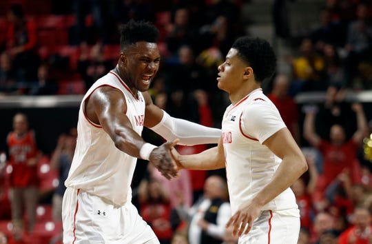 Maryland forward Bruno Fernando, left, celebrates with teammate Anthony Cowan Jr. after a play against Nebraska, Wednesday on Jan. 2.