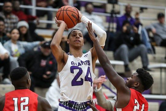 Ben Davis Giants Jalen Windham (24) shoots during the first half of Marion County quarterfinals at Ben Davis High School in Indianapolis, Wednesday, Jan. 9, 2019.