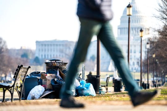 Trash is shown piled up on the National Mall in Washington, D.C., on Dec. 26, 2018, the fifth day of the partial government shutdown.
