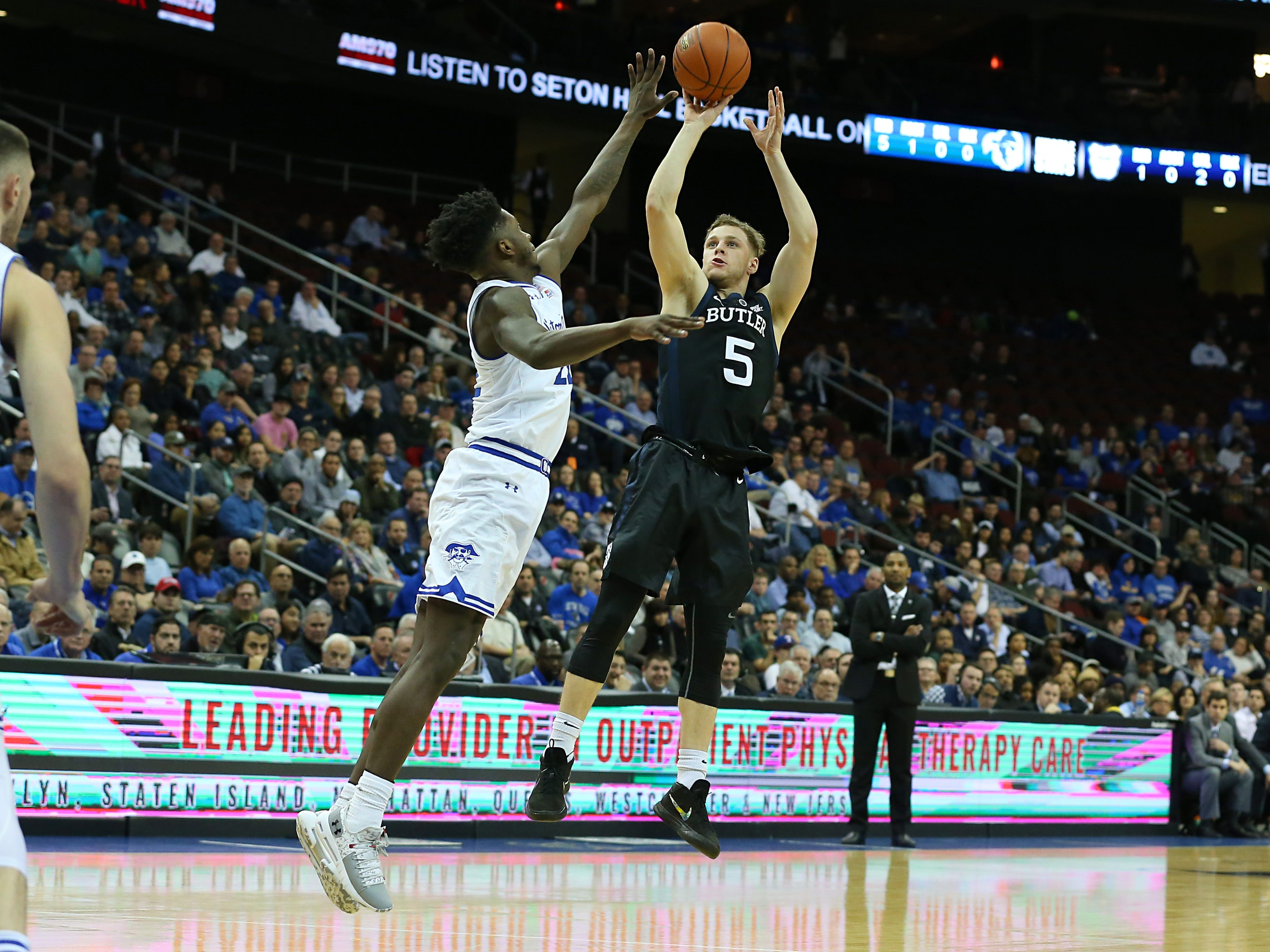 Jan 9, 2019; Newark, NJ, USA; Butler Bulldogs guard Paul Jorgensen (5) shoots the ball as Seton Hall Pirates guard Myles Cale (22) defends during the first half at Prudential Center. Mandatory Credit: Vincent Carchietta-USA TODAY Sports