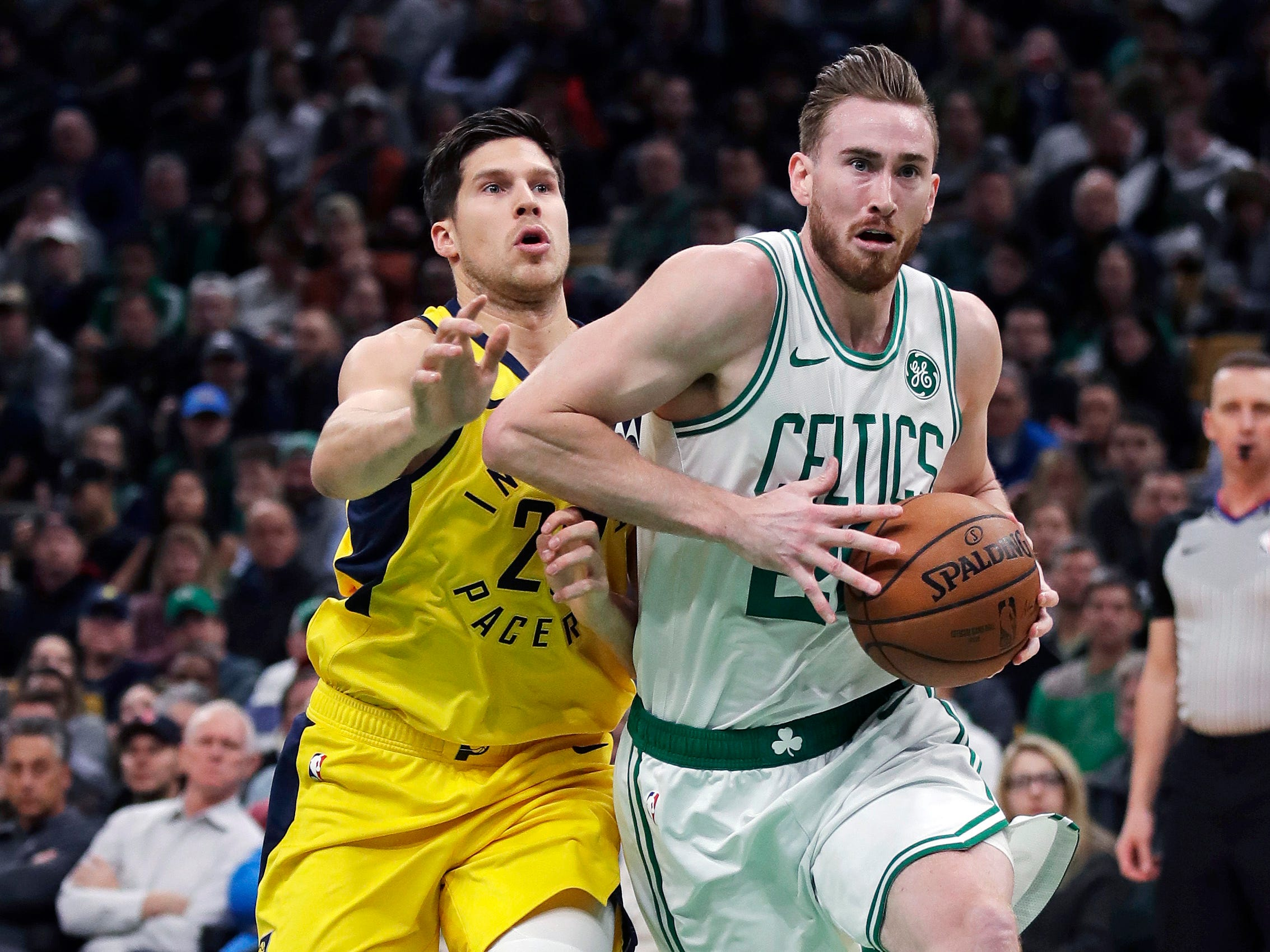 Boston Celtics forward Gordon Hayward, right, drives to the basket past Indiana Pacers forward Doug McDermott, left, during the second quarter of an NBA basketball game in Boston, Wednesday, Jan. 9, 2019.