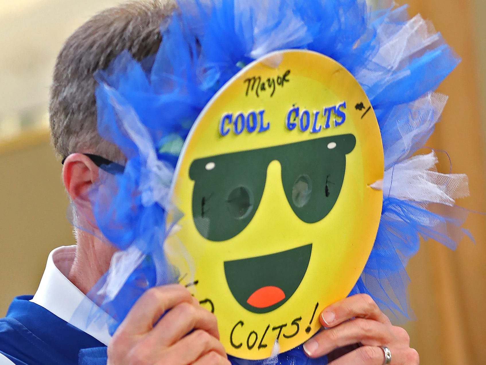 Mayor Joe Hogsett tries on a fan mask made for him by Lonna White at the City Market.  Fans had the opportunity to sign a 1-0 banner for the Colts at City Market, Thursday, Jan. 10, 2019.  The banner will be displayed for the team to see at the airport as they head off to their Kansas City playoff game.