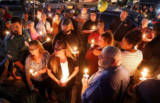 People attend a candlelight vigil for LaVon Drake on Wednesday night. Drake was killed Monday night while making pizza deliveries.   Matt Kryger/IndyStar Candlelight vigil for LaVon Drake