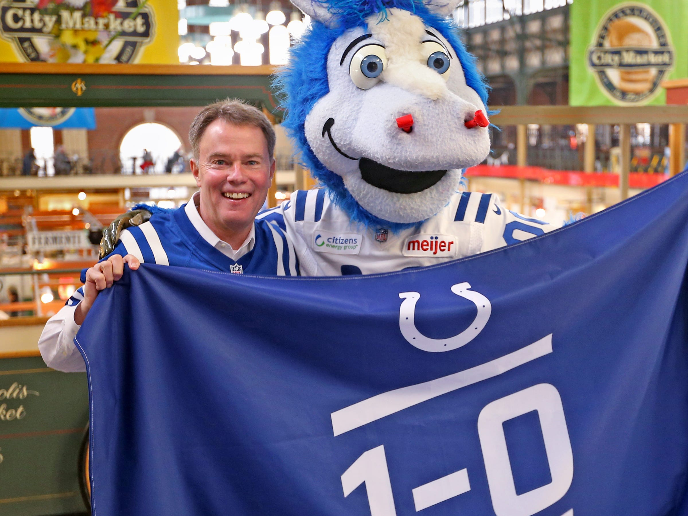 After Mayor Joe Hogsett and Colts mascot Blue signed a 1-0 banner for the Colts at City Market, Thursday, Jan. 10, 2019, the Colts presented his own 1-0 flag to the mayor.  The signed banner will be displayed for the team to see at the airport as they head off to their Kansas City playoff game.