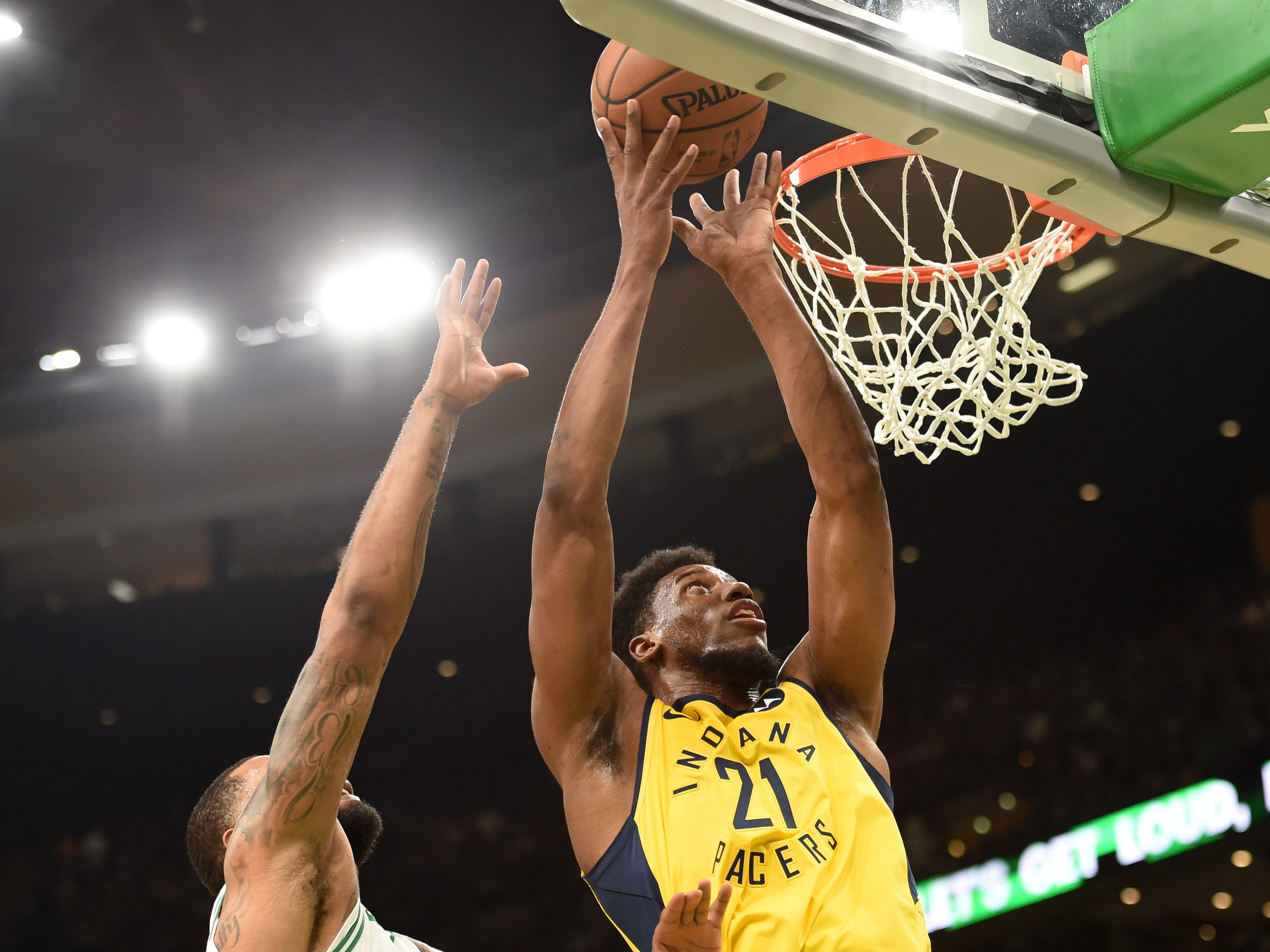 Jan 9, 2019; Boston, MA, USA; Indiana Pacers forward Thaddeus Young (21) lays the ball in the basket against Boston Celtics forward Marcus Morris (13) during the first half at TD Garden.
