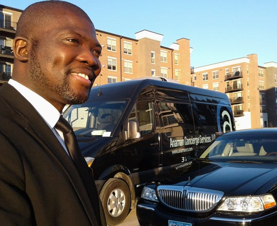 After only two years in business, Ghanaian immigrant and Iowa City entrepreneur Felix Anaman is proud of the progress of Anaman Concierge Services here.  This Mercedes van and Lincoln Town Car are among the five vehicles he offers clients.