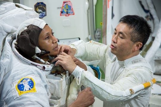 Astronaut Jeanette Epps, left, and Koichi  Wakata are shown training for an International Space Station Airlock mockup on Aug. 23, 2013. Photo, by James Blair, courtesy of NASA.