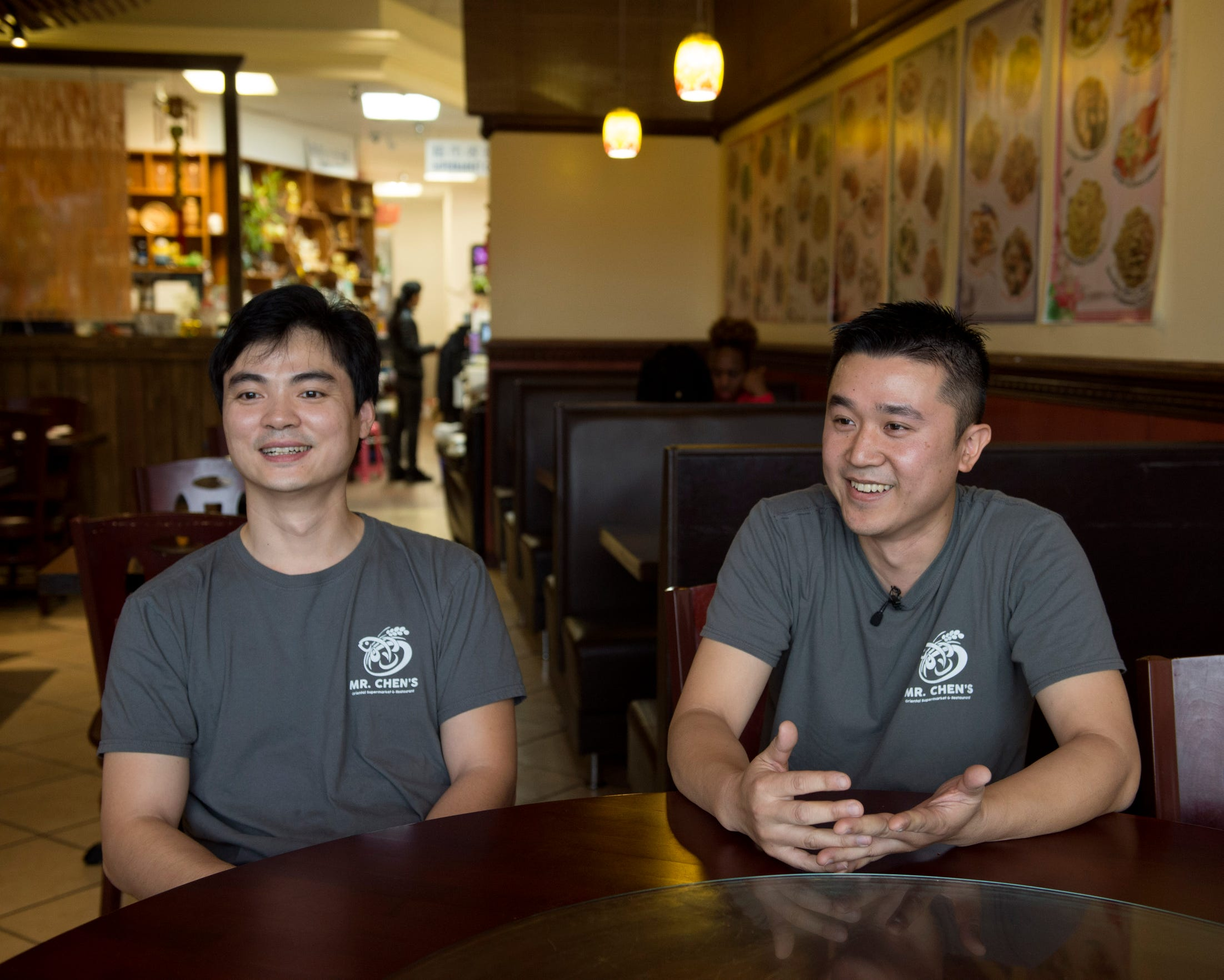 Mr Chen's owners Fisher Yu (left) and Jason Lin (right) sit in the dining area of their restaurant and grocery store in Jackson. Monday, Jan. 7, 2019.