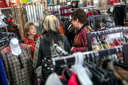 Felecia Teddleton, center, and Jan Wootten, right, speak with a customer that arrived the day Teddleton announced on Facebook she will be closing her Jackson location and starting a liquidation sale at Felecia-Bella's Boutique in Jackson, Tenn., on Thursday, Jan. 10, 2019.