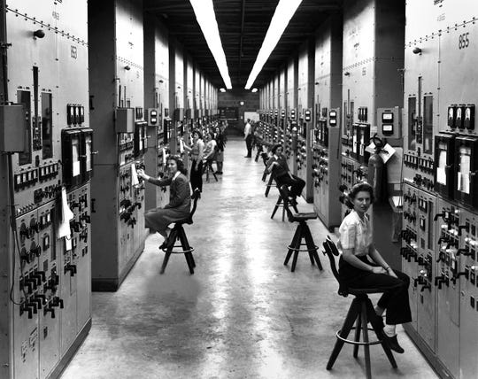 A photo by Ed Westcott shows women working on the Manhattan Project calutron.