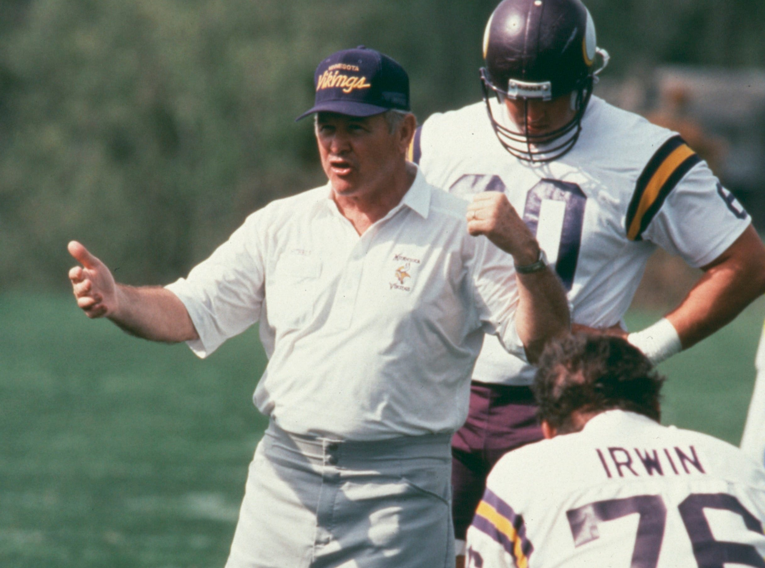 John Michels shown in an undated photo with Knoxville native Tim Irwin during practice with the Minnesota Vikings.