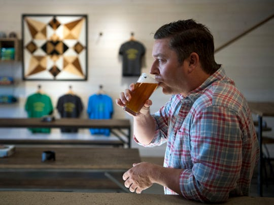 Roy Milner, chief fermentation officer at Blackberry Farm Brewery, with his first beer at the brewery's taproom on Wednesday, January 9, 2019.