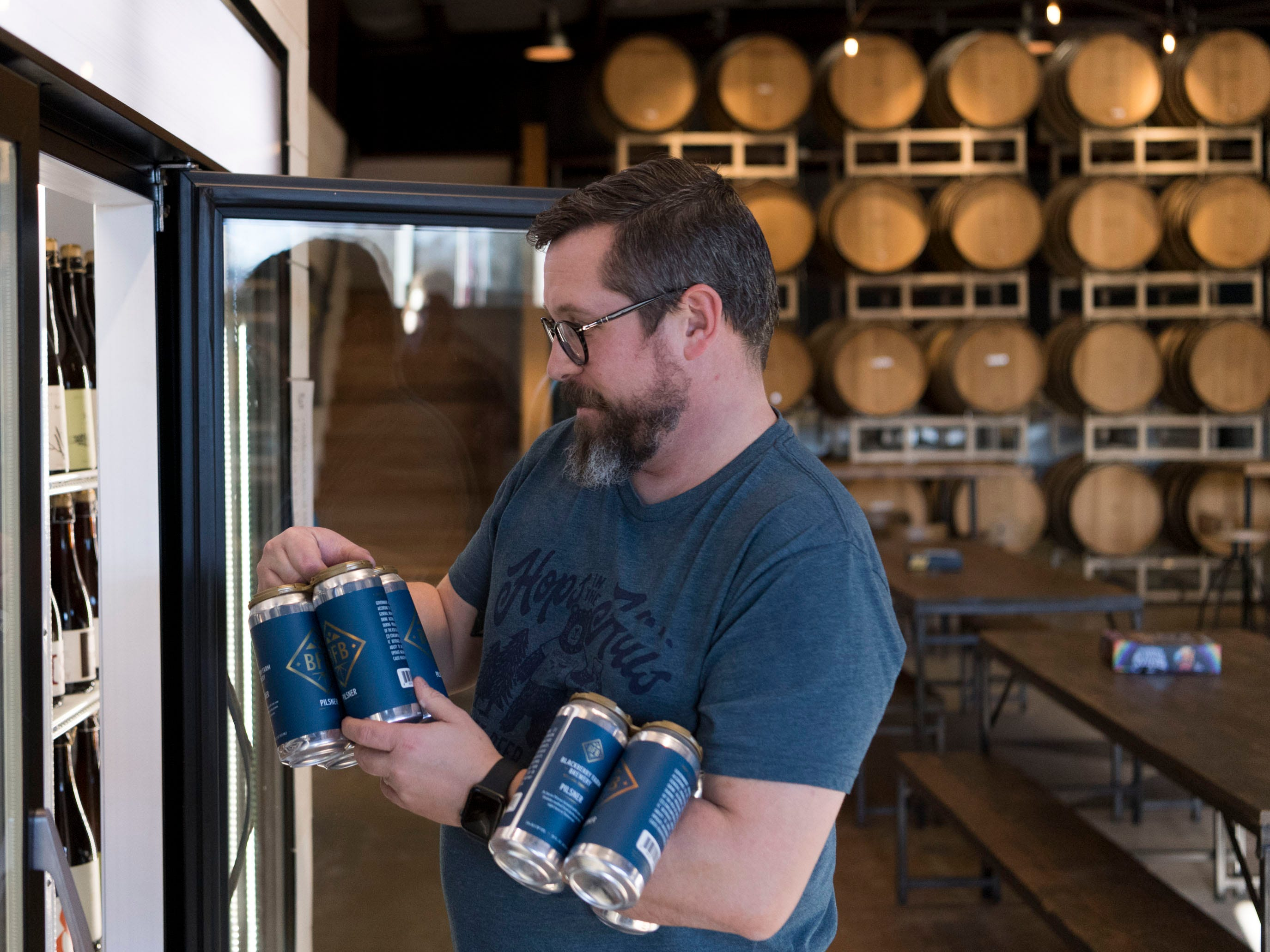 Andrew Noye, brewery manager at Blackberry Farm Brewery, stocks a cooler with two exclusive brews, the Scream Bock dark wheat ale and a pilsner on Wednesday, January 9, 2019.