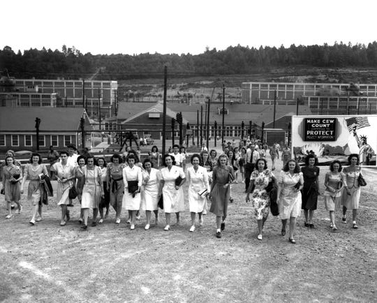 Shift change at the Manhattan Project's Y-12 plant in 1945.