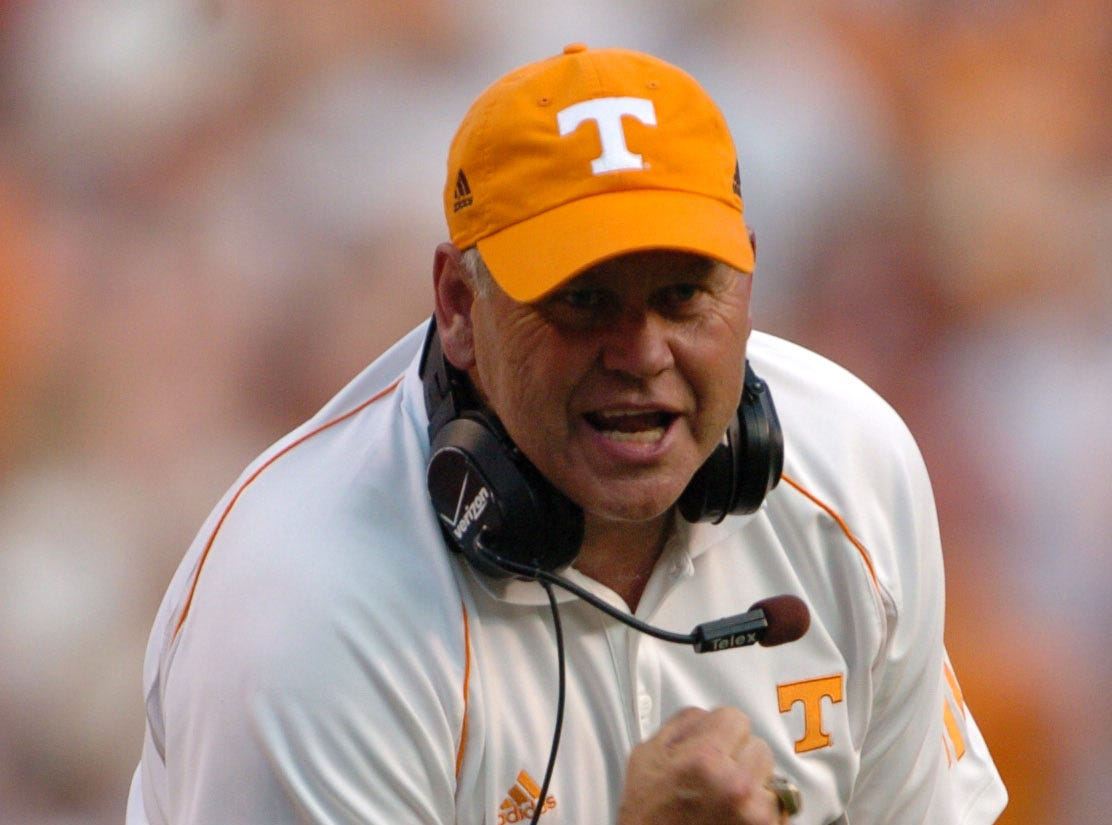 0902utcal.JA#6271.jpg -- sports --  UT coach Phillip Fulmer celebrates a touchdown by Robert Meachem in the third quarter against Cal on Saturday at Neyland Stadium. The Vols won the season opener with ease, 35-18.Jeff Adkins/NEWS SENTINEL ----09/02/2006.