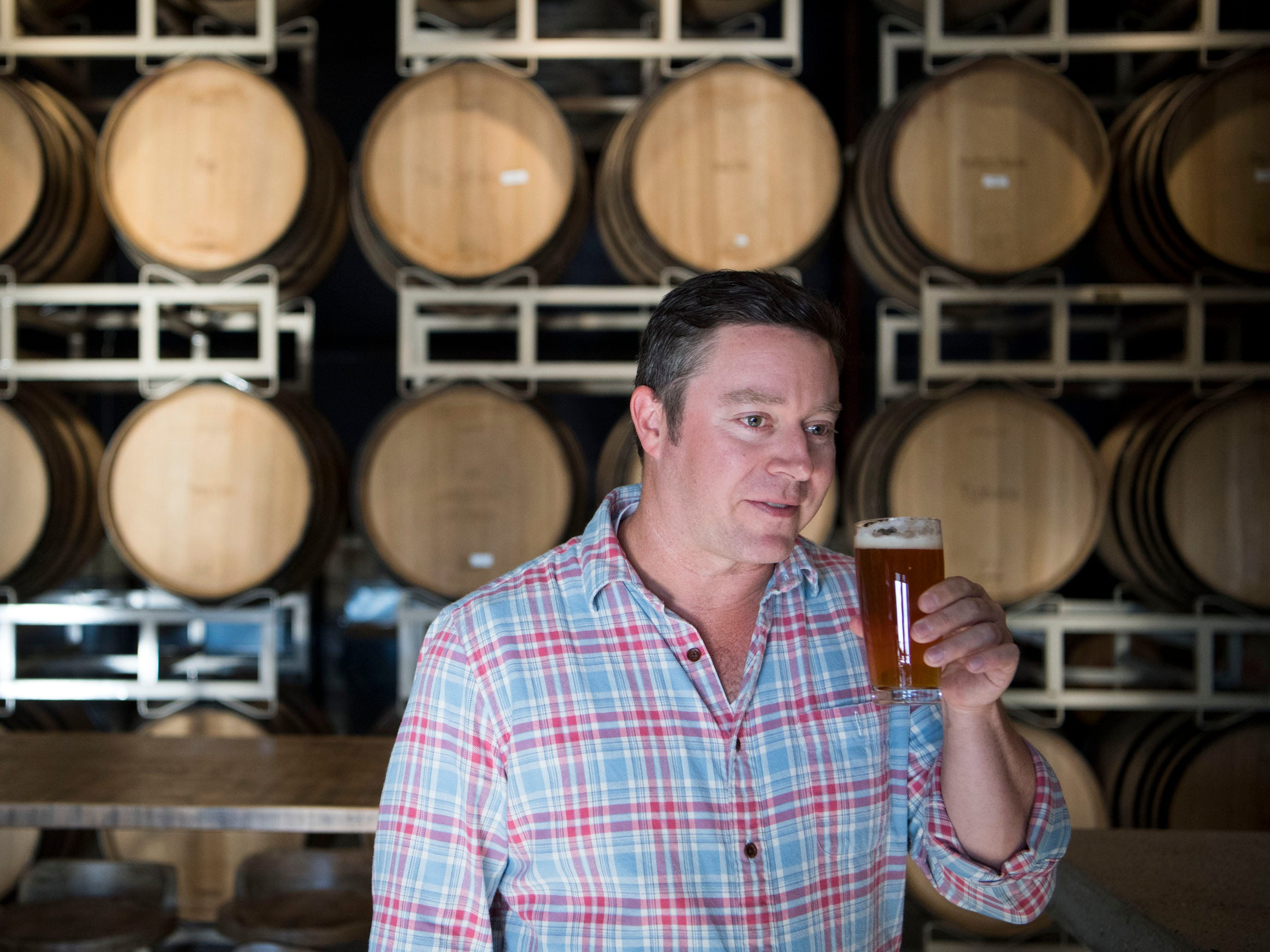 Roy Milner, chief fermentation officer at Blackberry Farm brewery taproom on Wednesday, January 9, 2019.