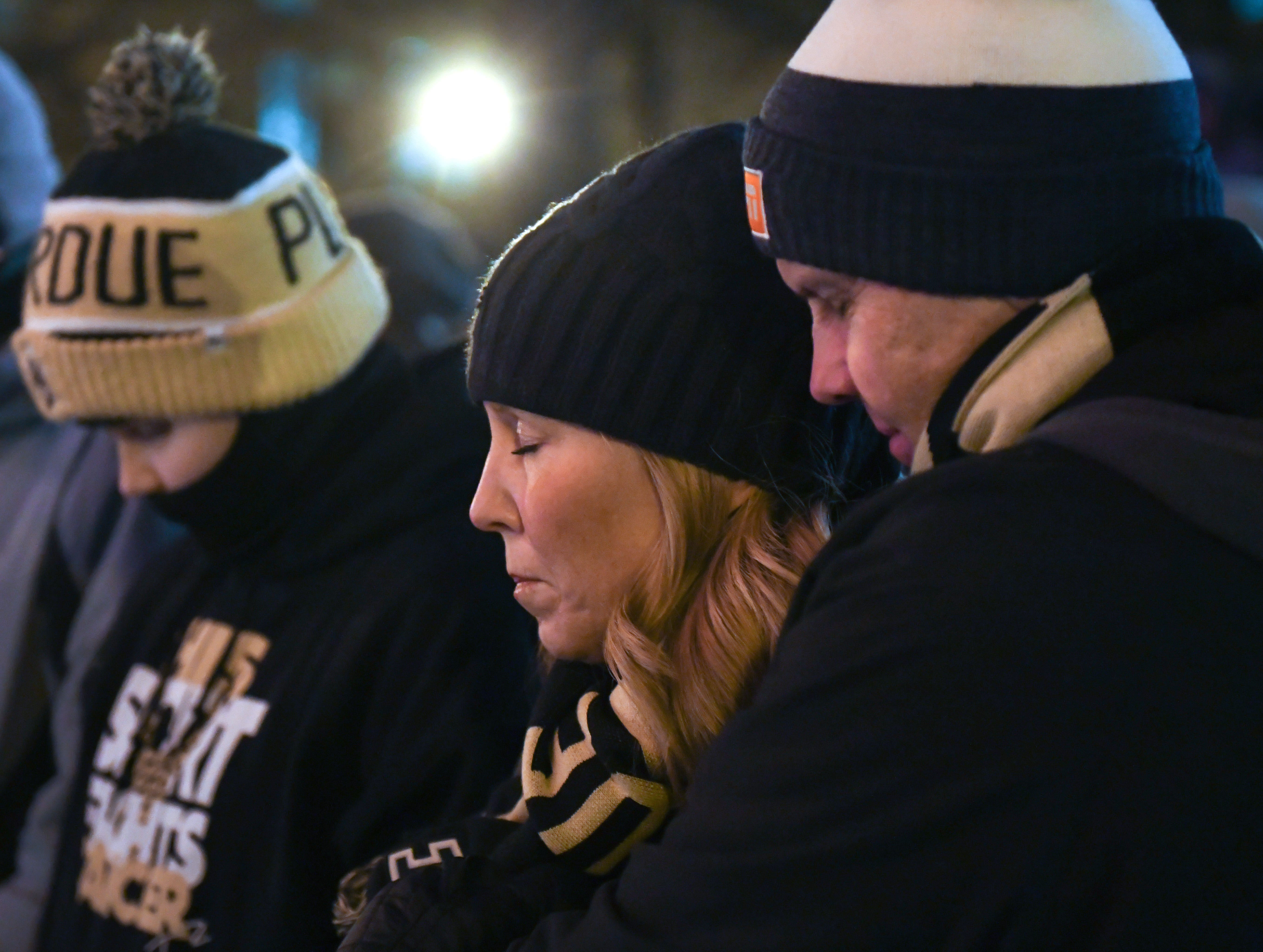 Tony and Kelly Trent pray during a memorial service and candlelight vigil for their son Tyler at Purdue University in West Lafayette on January 9, 2019.