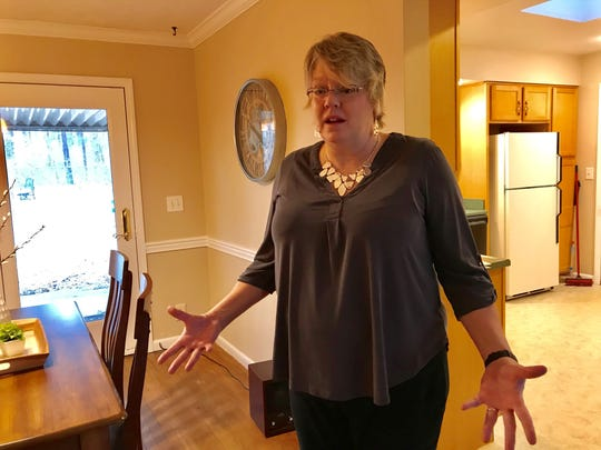 Meg Howlett, a Lafayette real estate agent, describes the waiting game for a house on Homewood Drive, west of West Lafayette, where buyers and sellers are waiting for the end of the federal shutdown to close on a USDA-backed loan.