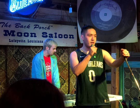 Cole Pham, right, a 22-year-old rapper and 2014 graduate of Lafayette High, performs at the Blue Moon Saloon.