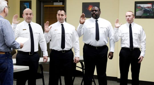 Greenfield Township Trustee Kent Searle, left, swears in (from left to right) Greenfield Township Fire Chief Brad Smith, second from left, Capt. Cory Spires, Lt. Carlton Reaves and firefighter Colin Osterman Wednesday night, Jan. 9, 2019, in Greenfield Township. All four firefighters served in previous roles with the fire department.
