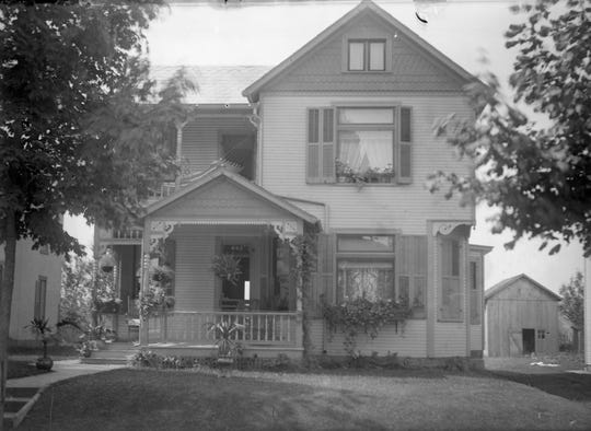 This house stands today at 662 E. Main St. The unidentified photo  (circa 1910) was matched to its location even after 100 years of owners and changes.