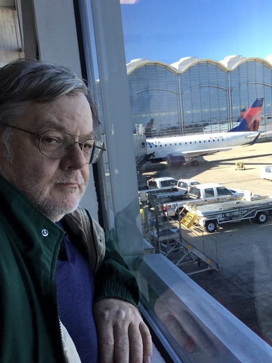 Jim Pratt, an Oceola Township resident, waits for a plane on Jan. 10, 2019 in Washington, D.C. Pratt is an FAA safety inspector currently on furlough because of the shutdown.