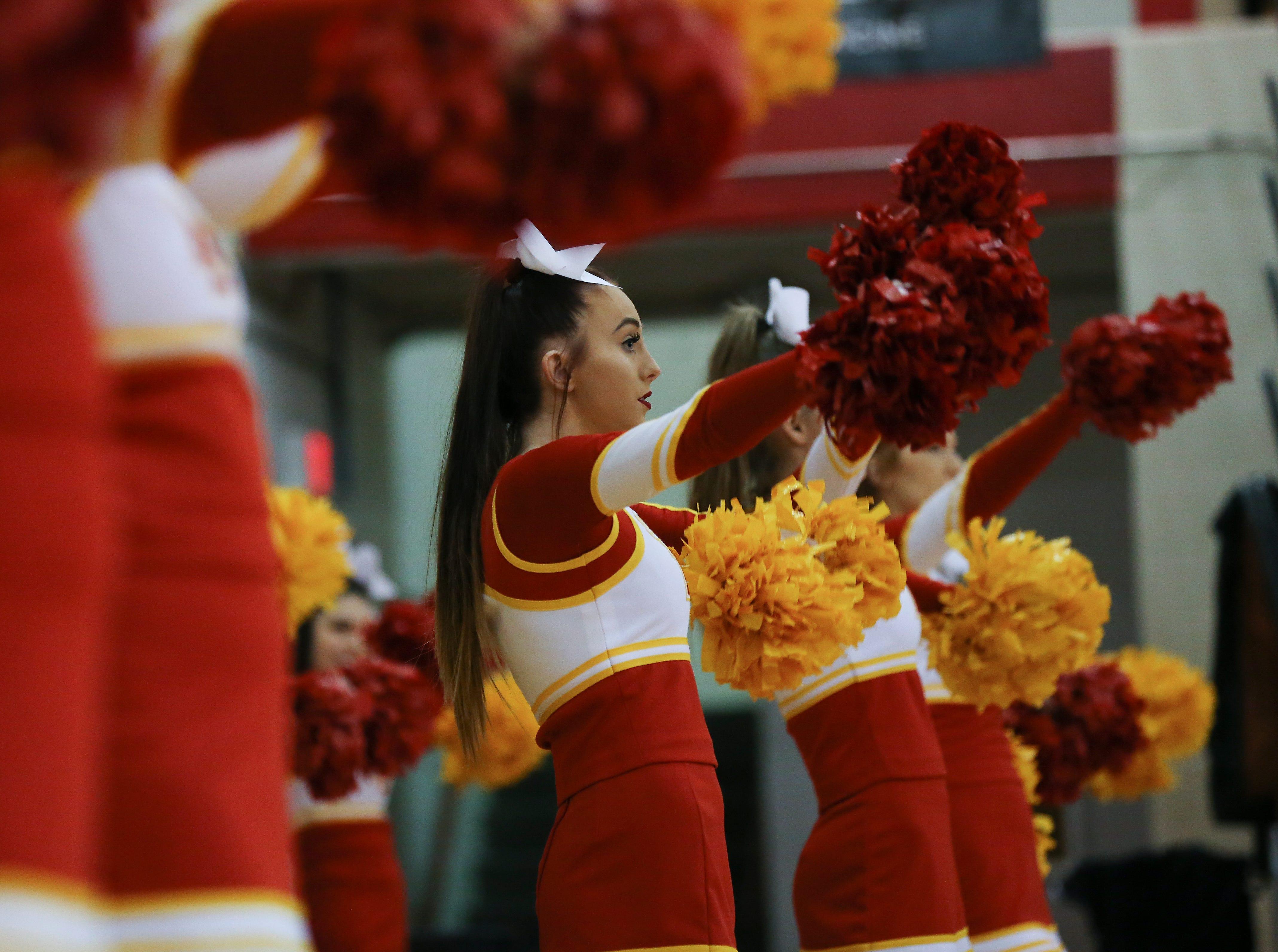 The Bullitt East cheerleaders peformed as Mercy played against Bullitt East at the Bullitt East High School.Jan. 9, 2019