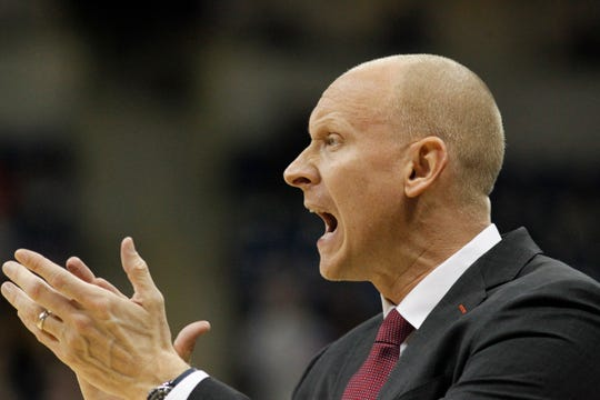 Jan 9, 2019; Pittsburgh, PA, USA;  Louisville Cardinals head coach Chris Mack gestures on the sidelines against thePittsburgh Panthers during the first half at the Petersen Events Center.