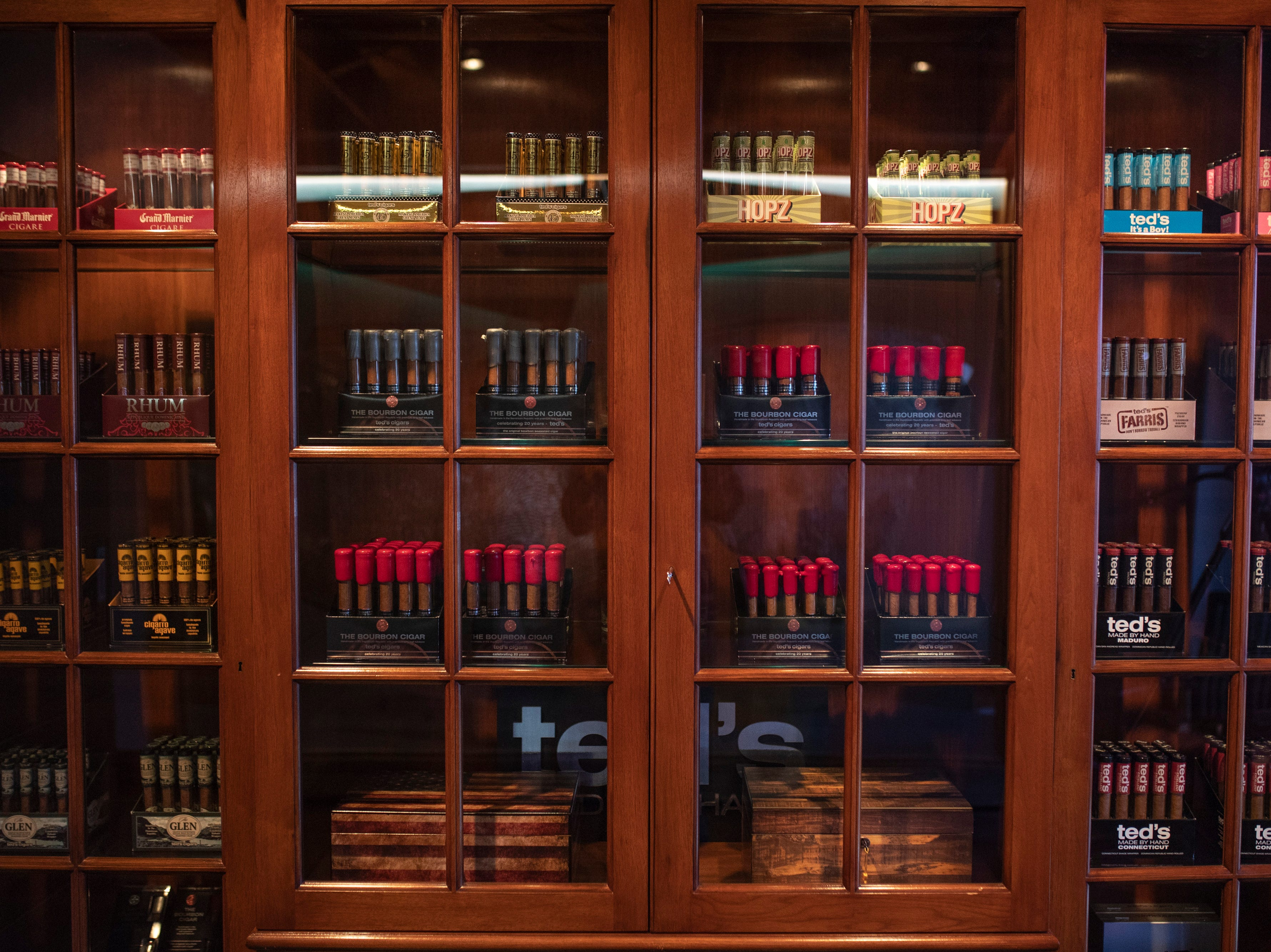 A case holds various types of flavored cigars made by Ted's Cigars in Louisville. Flavors range from rum to beer hops, from bourbon to agave. Jan. 10, 2019