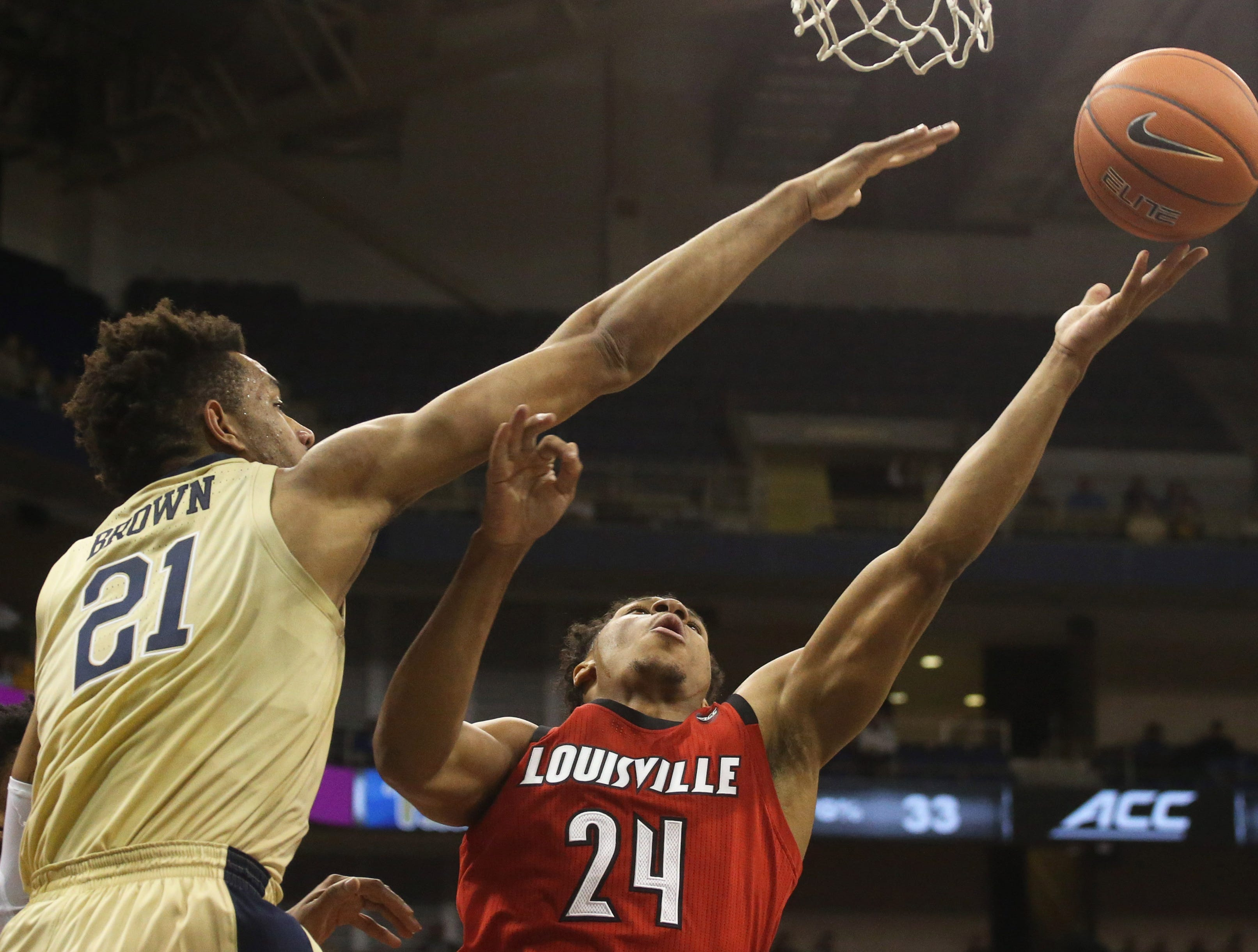 Jan 9, 2019; Pittsburgh, PA, USA;  Pittsburgh Panthers forward Terrell Brown (21) defends Louisville Cardinals forward Dwayne Sutton (24) during the first half at the Petersen Events Center.