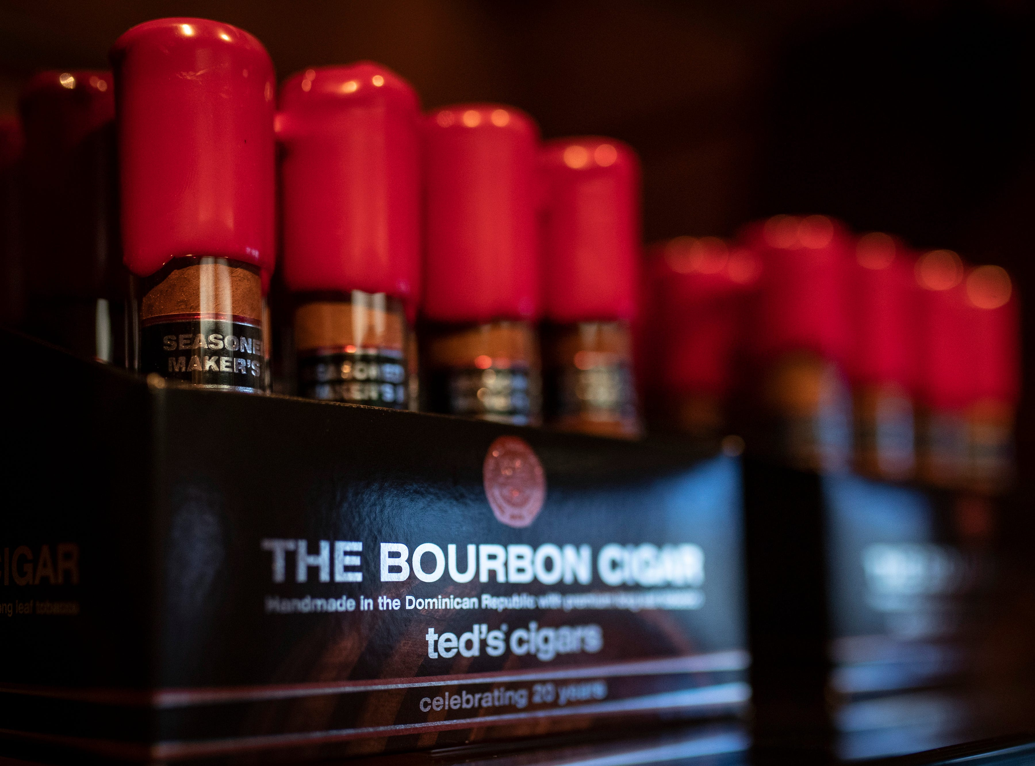 Maker's Mark and Louisville cigar maker spar over famous red wax drip
