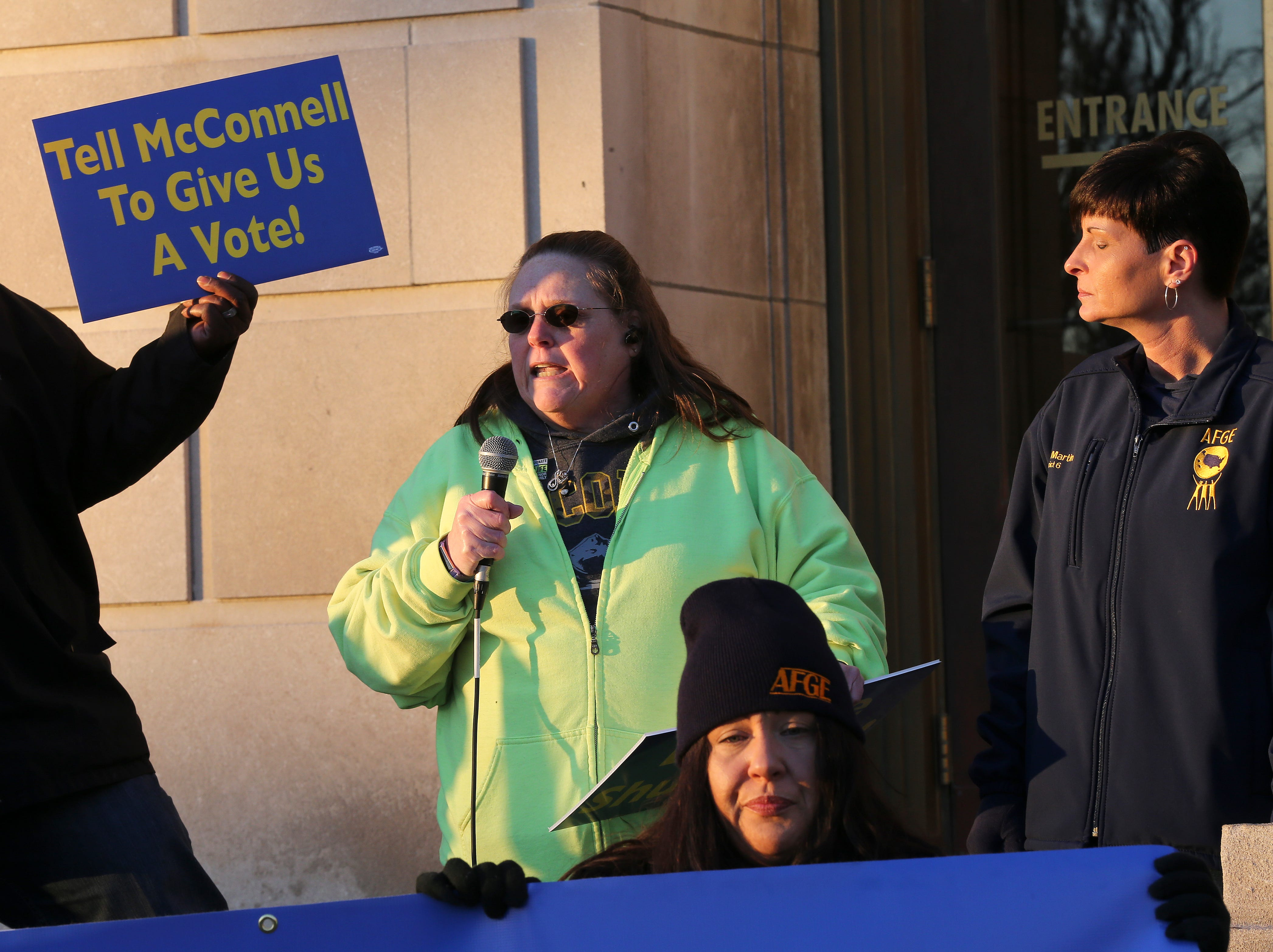 Jeffersonville Census Bureau employee Liddy Cleary told a group of protesters that she may lose her home in February if the government shutdown doesn't end.  They were rallying outside the federal courthouse in Louisville.