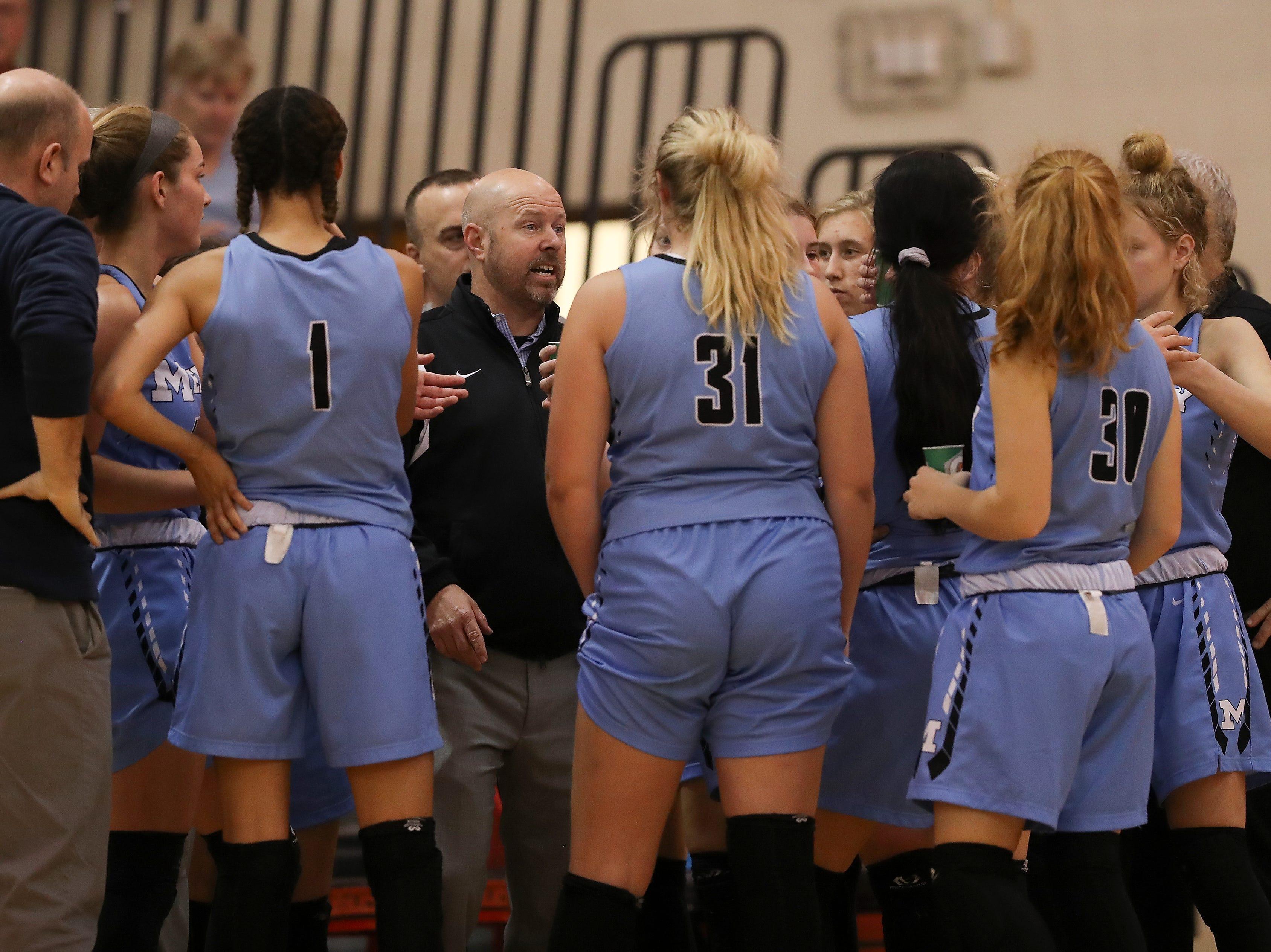 Mercy head coach Keith Baisch instructed his team against Bullitt East at the Bullitt East High School.Jan. 9, 2019